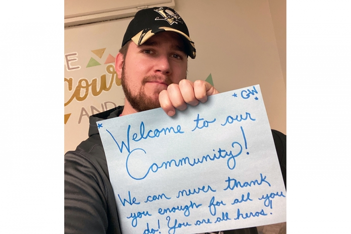 Area Coordinator Nick welcomes these heroes to the community and thanks them for all they do.